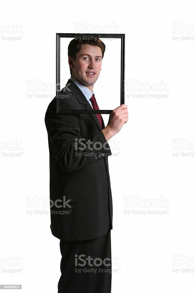 Man holding a frame stock photo