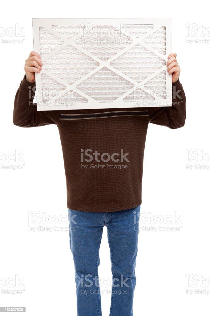 Man Holding a Furnace Air Filter royalty-free stock photo