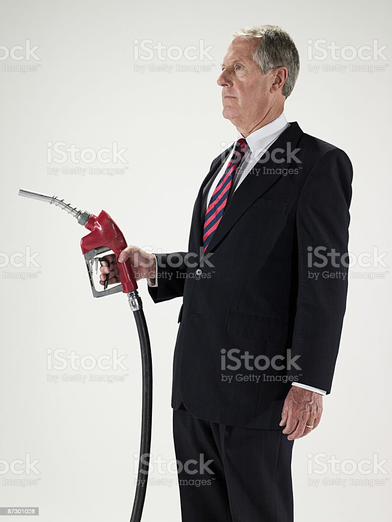 Man holding a gas pump stock photo