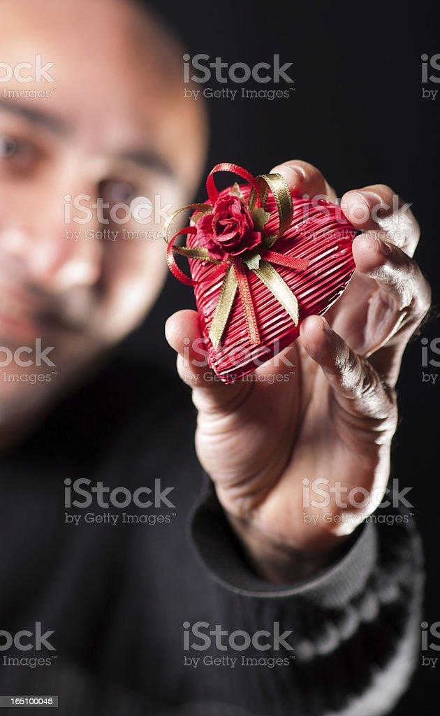 man holding a gift pack royalty-free stock photo
