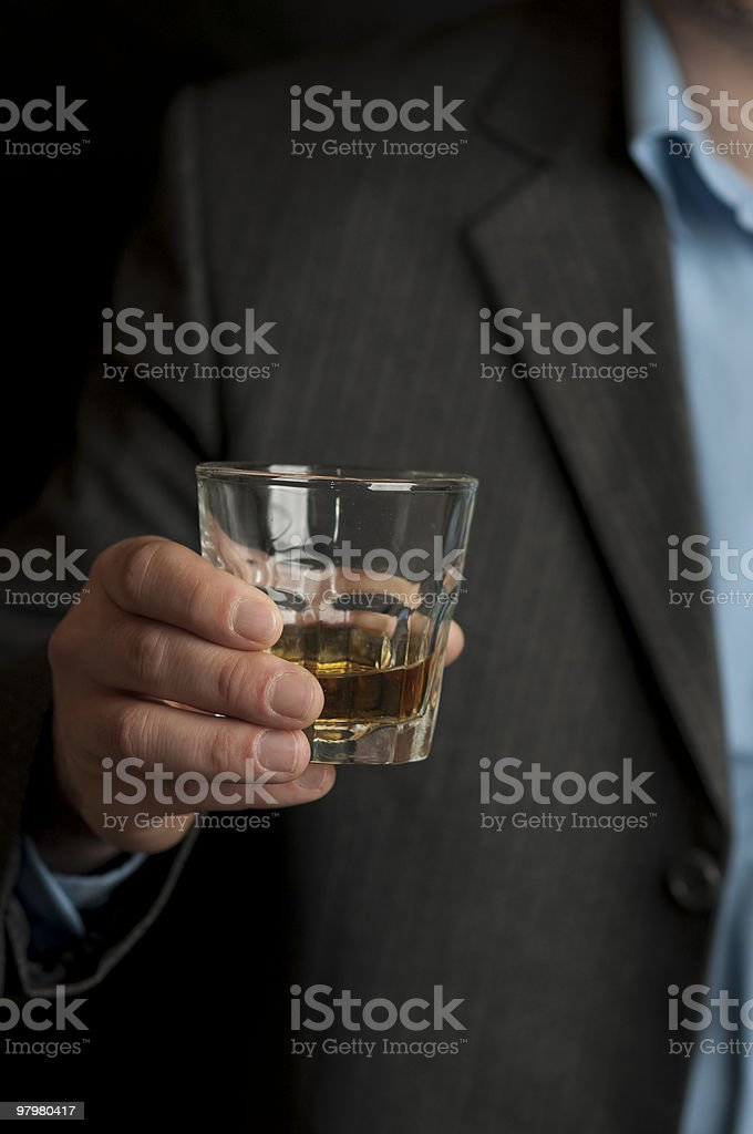 Man holding a glass of whiskey stock photo