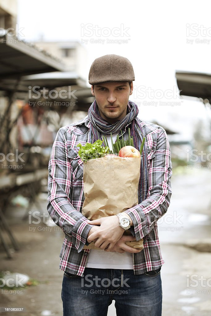 man holding a grocery bag royalty-free stock photo