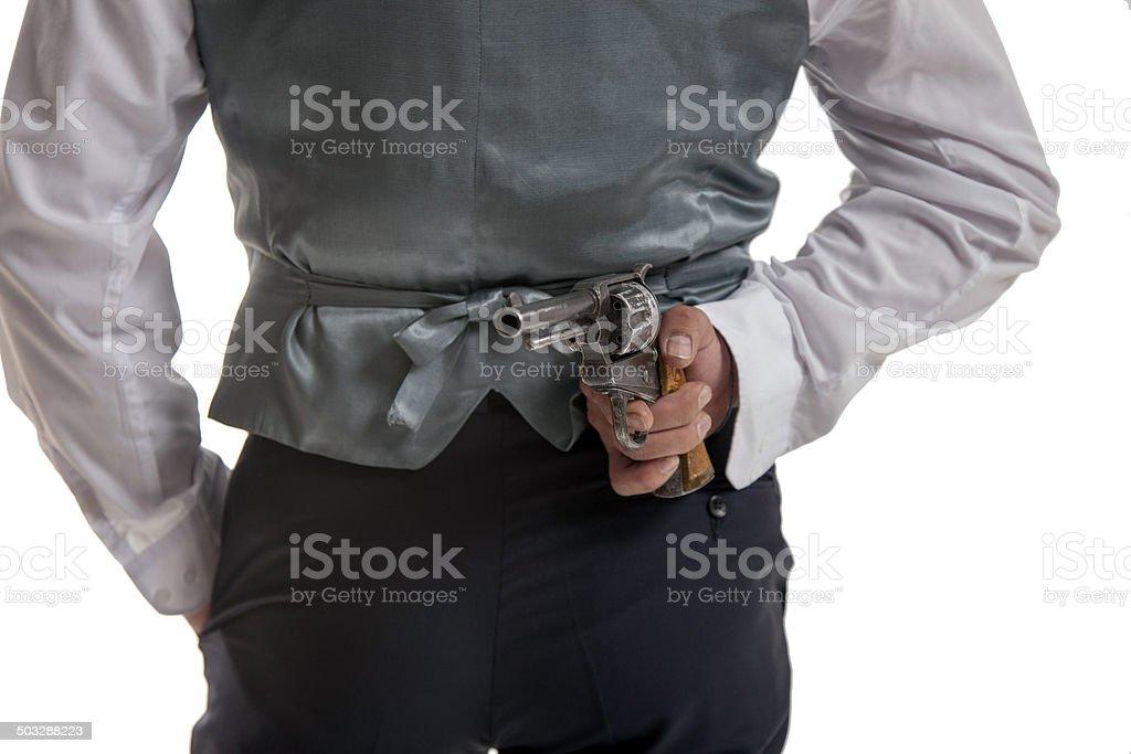 Man holding a gun behind his back royalty-free stock photo
