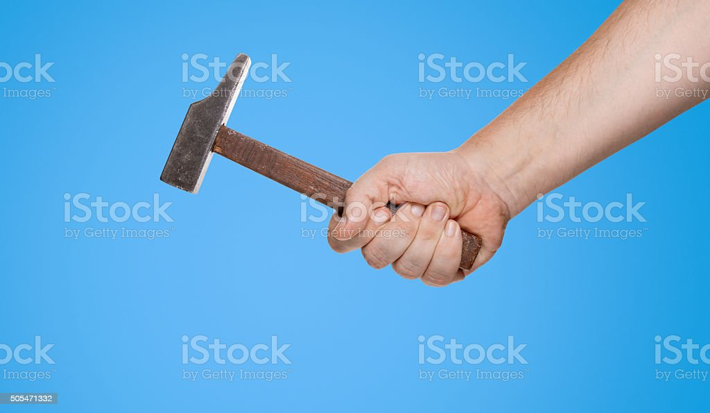 Man holding a hammer in his hand (clipping path) stock photo
