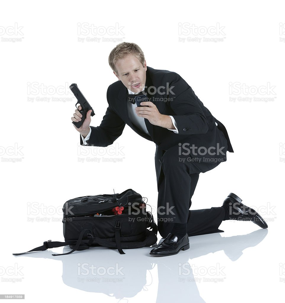 Man holding a hand gun and reading text message on stock photo