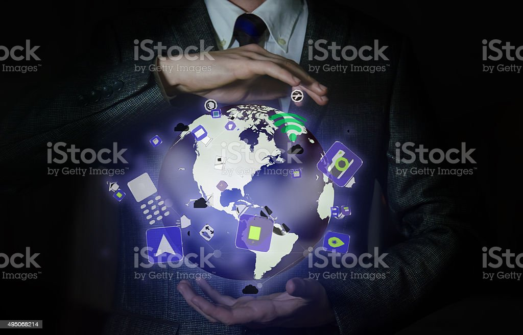 man holding a hologram of the earth with the network stock photo