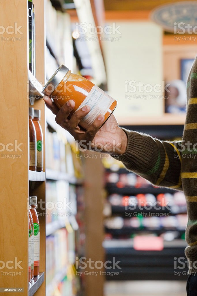 Man holding a jar at the supermarket stock photo