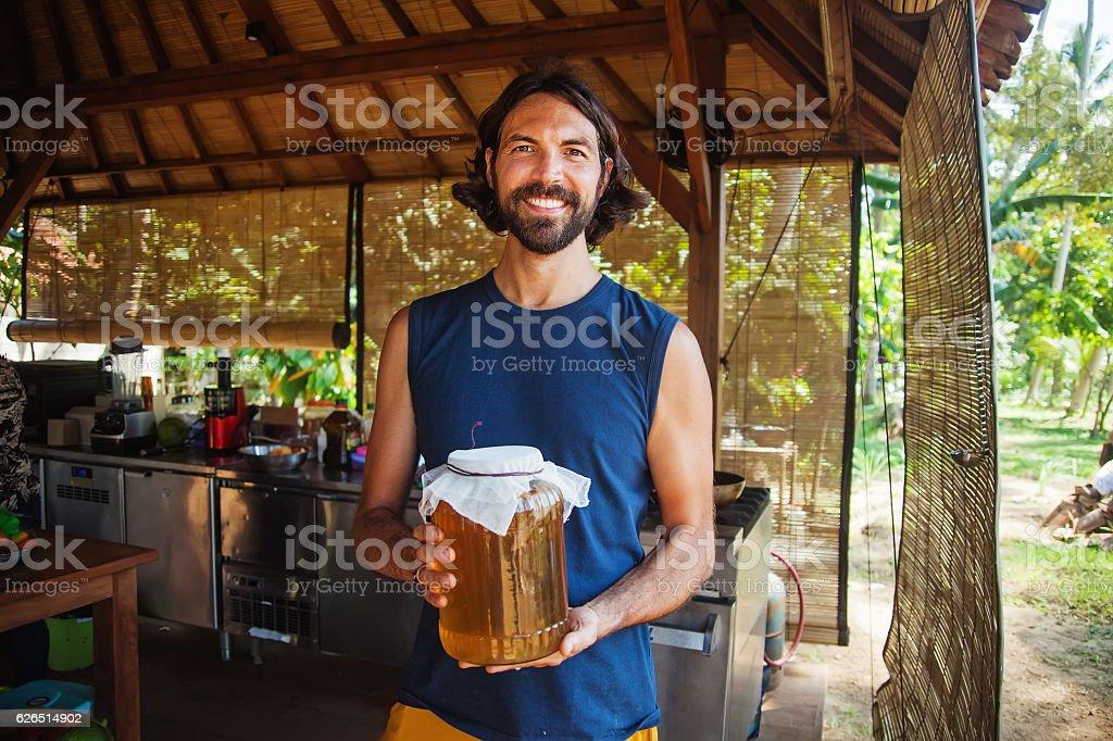 Man holding a jar of honey stock photo