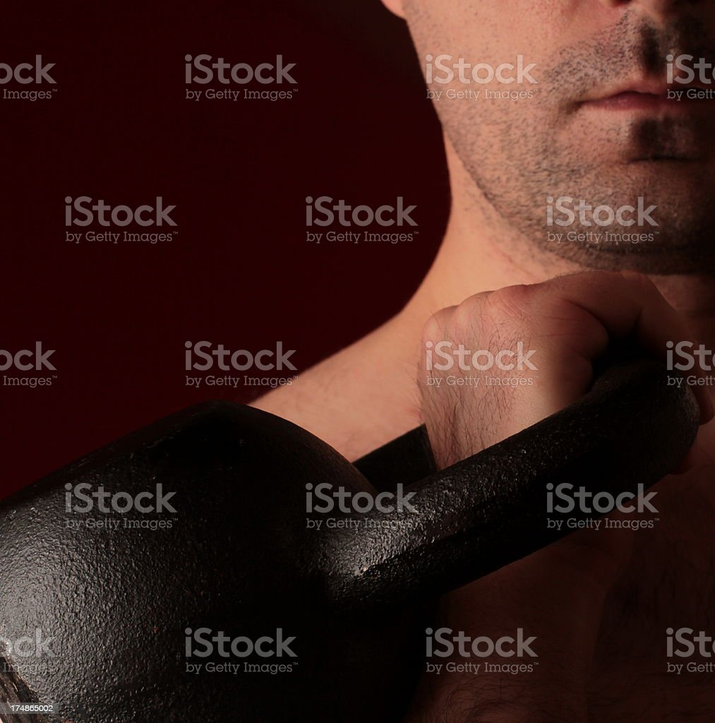 man holding a kettlebell royalty-free stock photo
