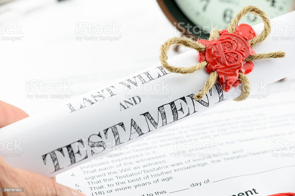 Man holding a last will and testament stock photo