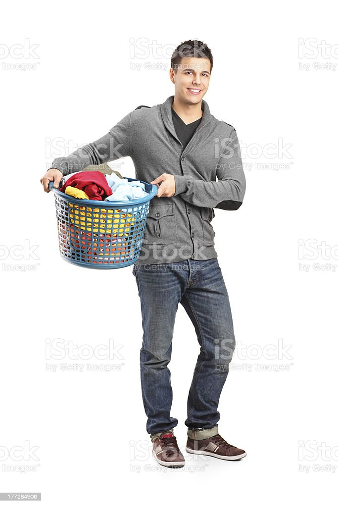 Man holding a laundry basket stock photo