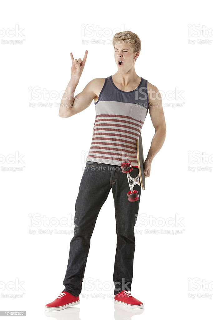 Man holding a long board and gesturing royalty-free stock photo