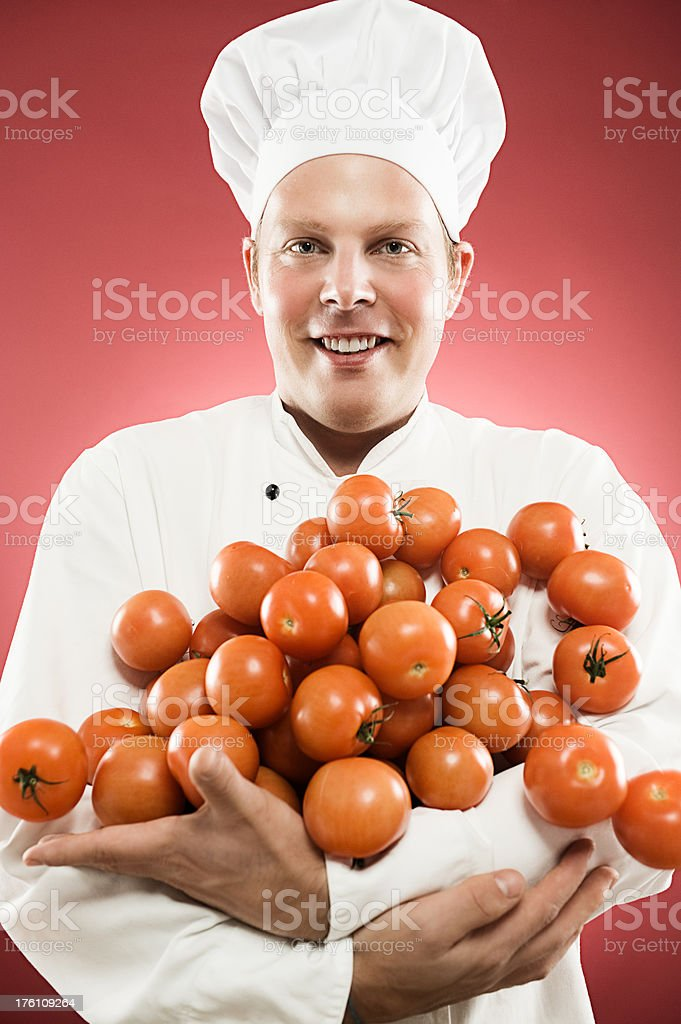 Man holding a lot of tomatos royalty-free stock photo