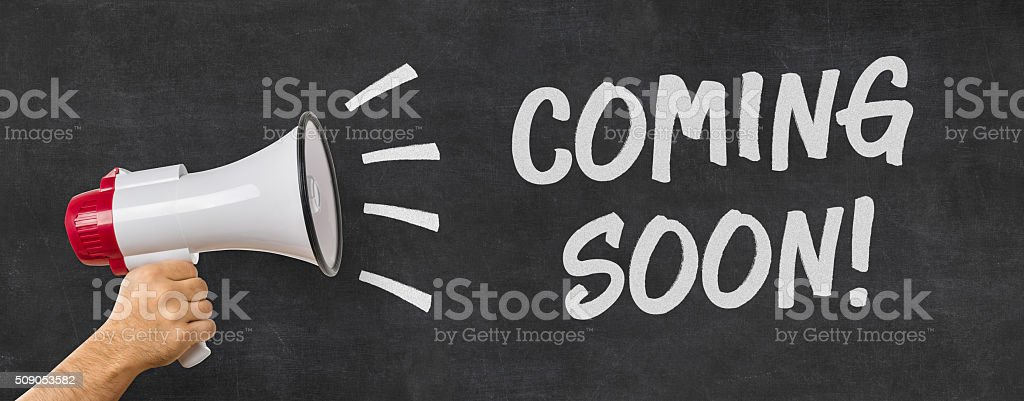 Man holding a megaphone - Coming soon stock photo