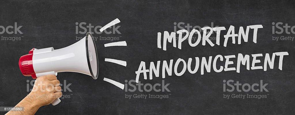 Man holding a megaphone - Important announcement stock photo