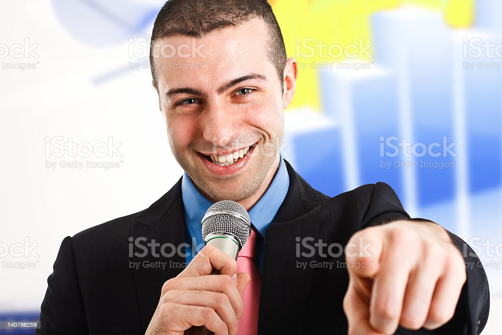 Man holding a microphone stock photo