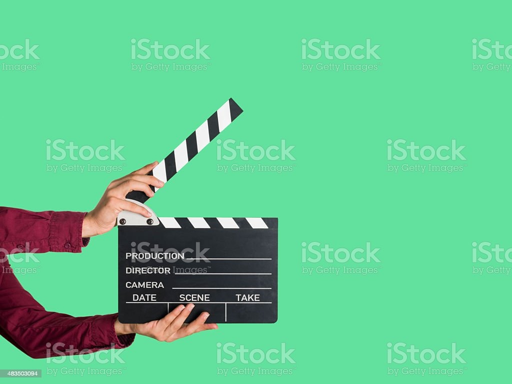 Man holding a movie clapperboard stock photo