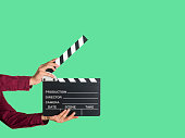 Man holding a movie clapperboard
