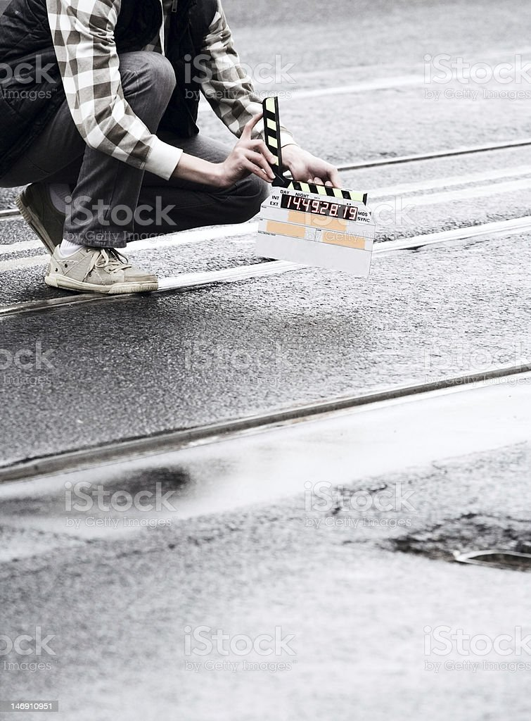 Man holding a movie making sign stock photo