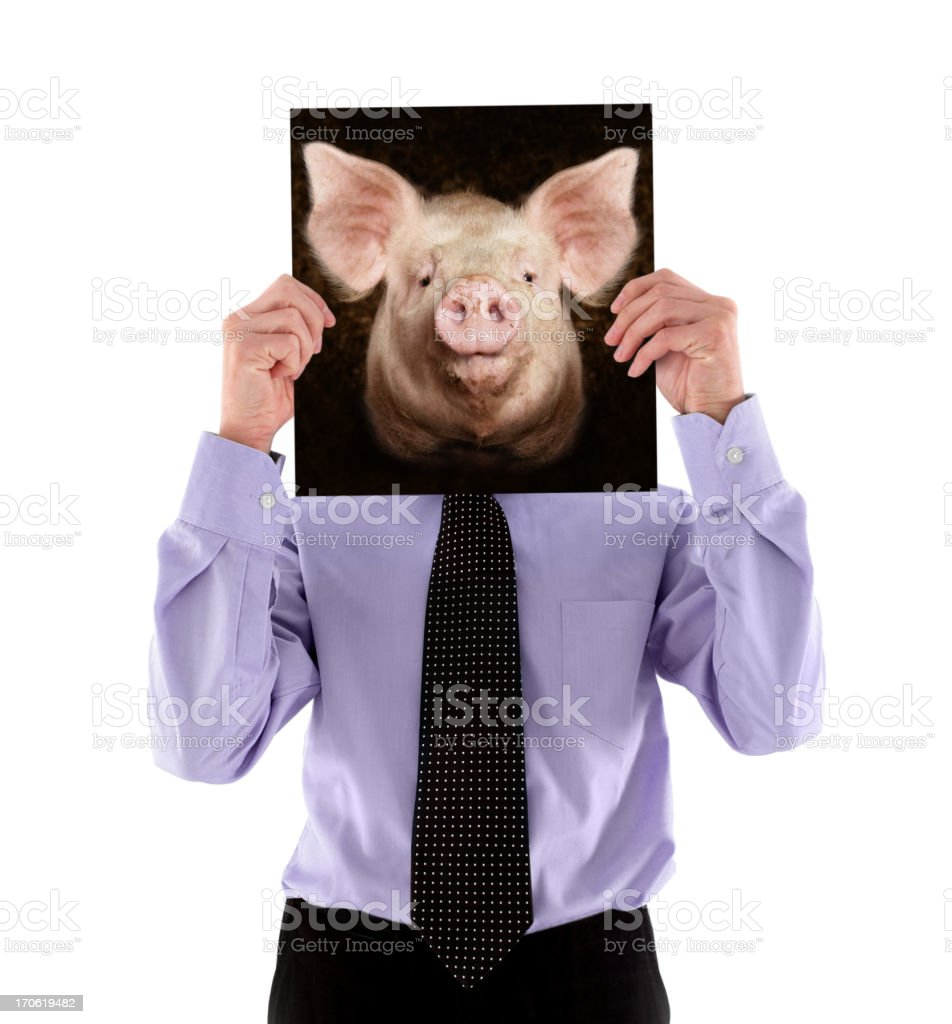 Man Holding a Photo of Pig's Head stock photo