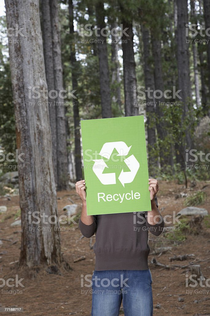 A man holding a recycling sign royalty-free stock photo