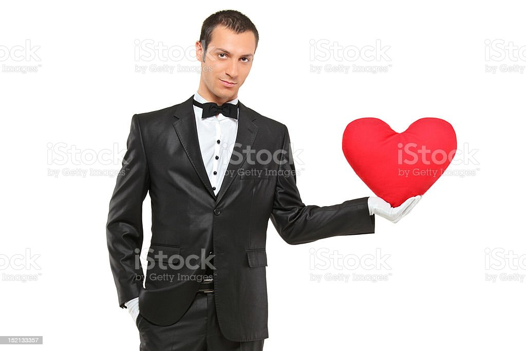 Man holding a red heart-shaped pillow stock photo