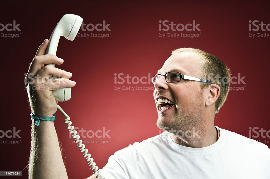 Man holding a retro phone and smiling royalty-free stock photo