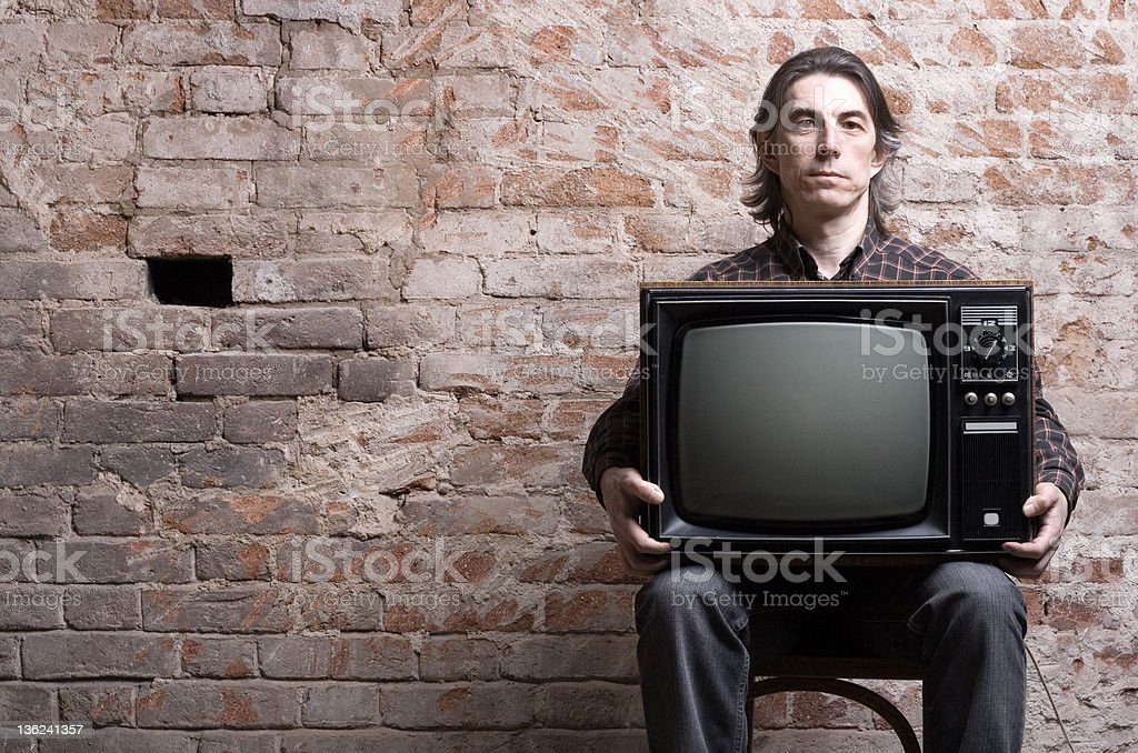 man holding a retro television royalty-free stock photo
