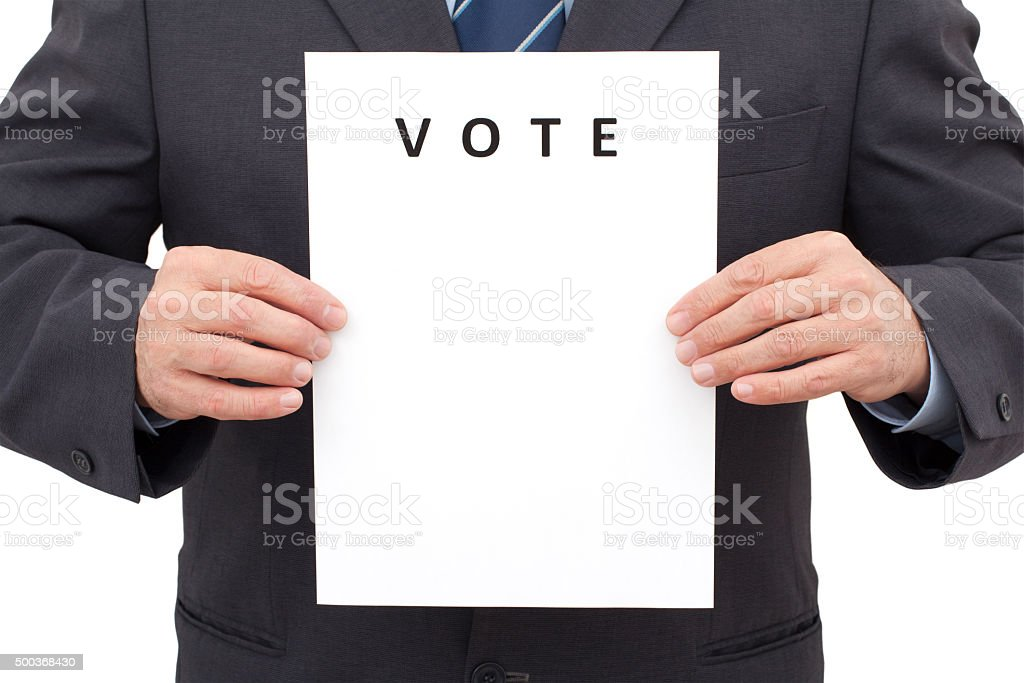 Man, Holding a Sheet with Title VOTE stock photo