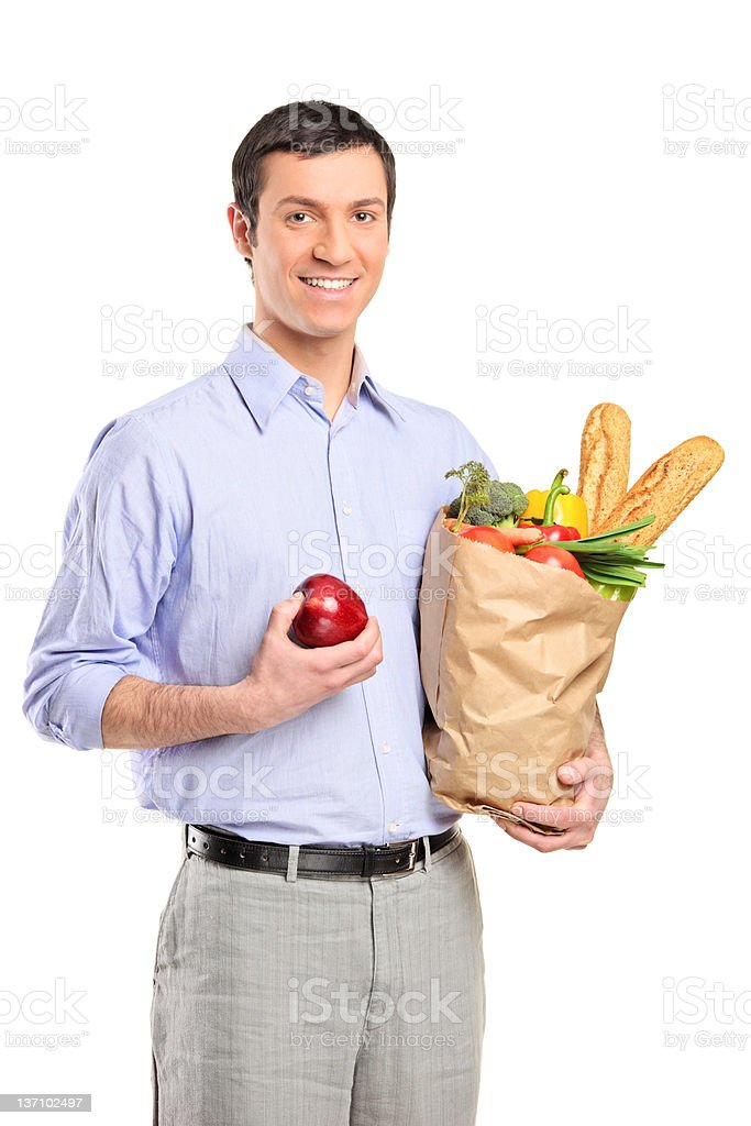 Man holding a shopping bag and an apple royalty-free stock photo