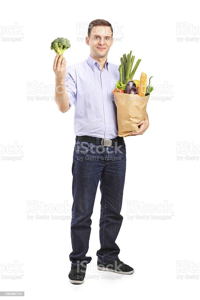 Man holding a shopping bag royalty-free stock photo
