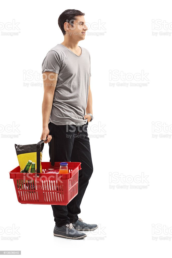 Man holding a shopping basket waiting in line stock photo