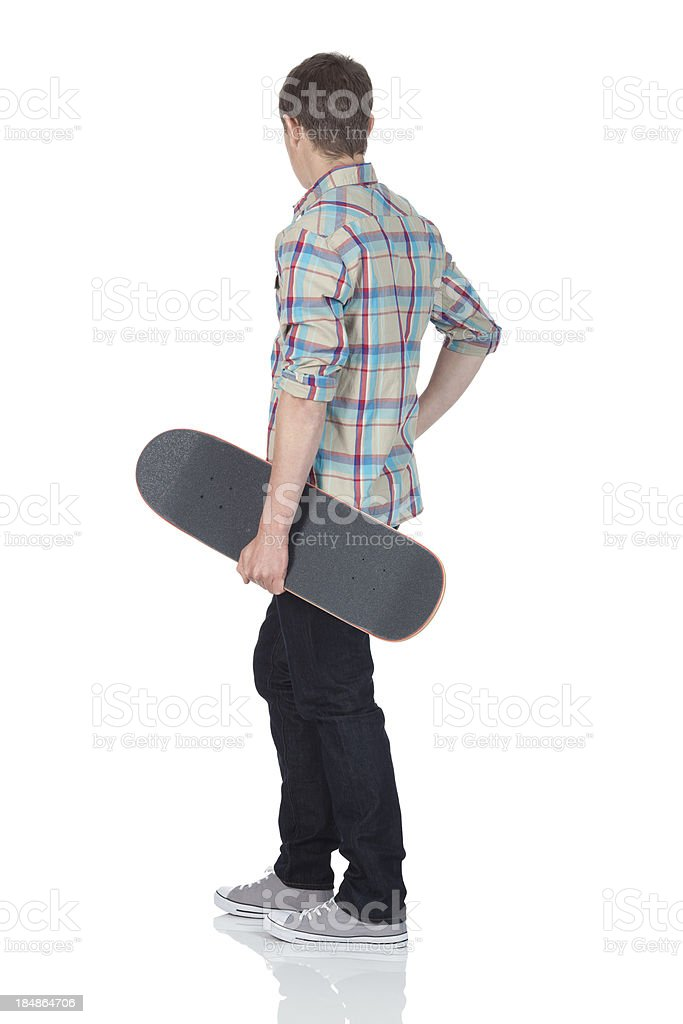 Man holding a skateboard royalty-free stock photo