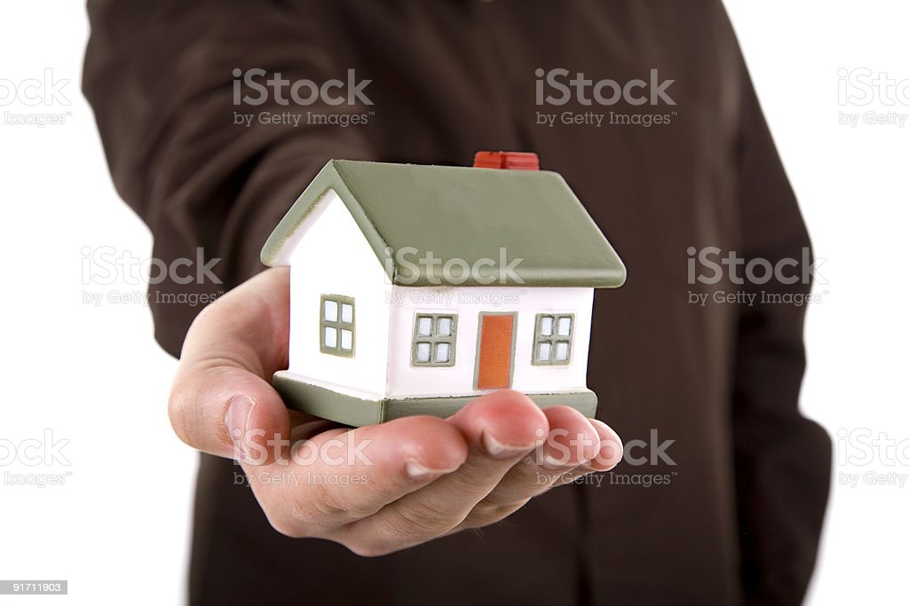 man holding a small house in his hand royalty-free stock photo