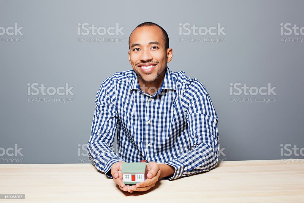 Man holding a small house royalty-free stock photo