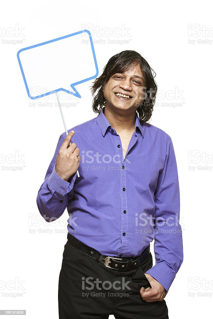 Man holding a speech bubble sign smiling royalty-free stock photo
