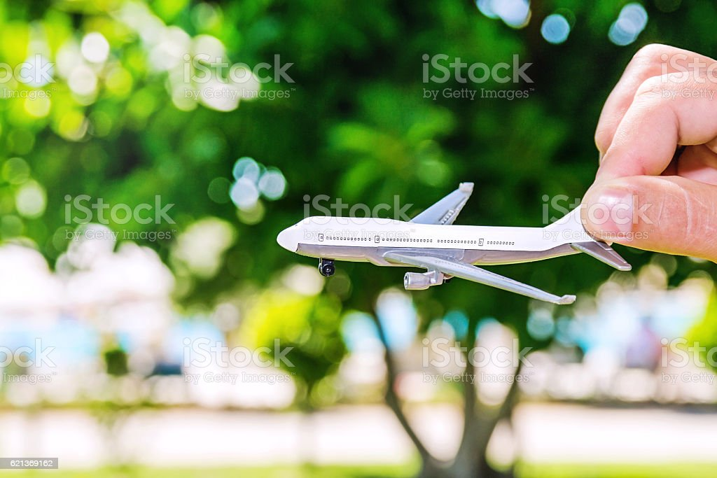 Man holding a toy airpline in hand stock photo