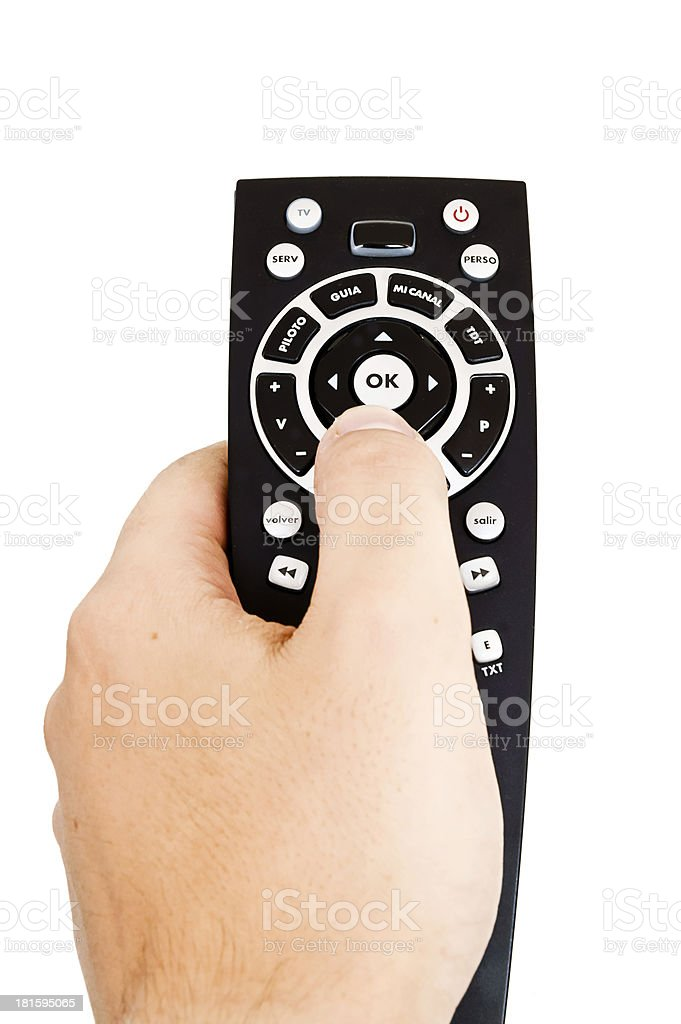 man holding a tv remote royalty-free stock photo
