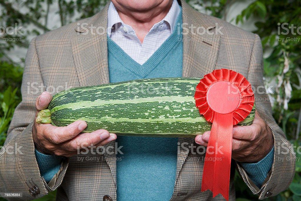Man holding a winning marrow stock photo