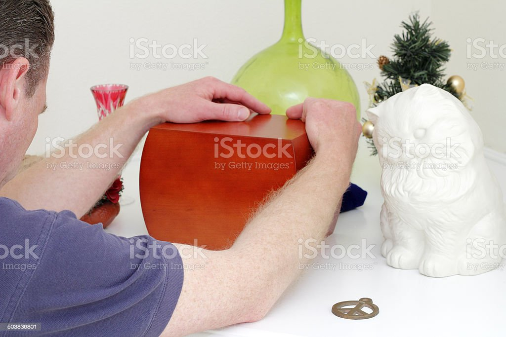 Man Holding a Wood Urn stock photo