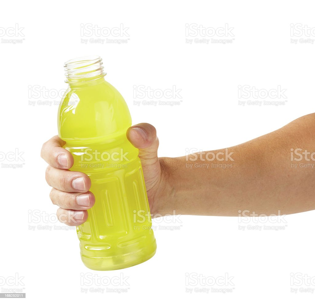 Man holding a yellow sports drink stock photo