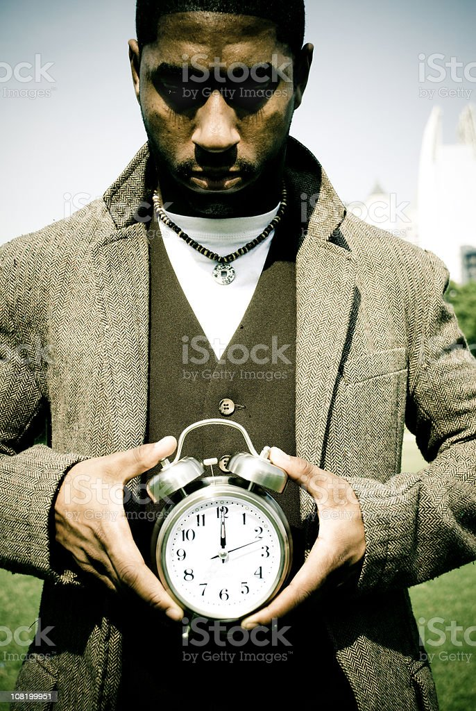 Man Holding Alarm Clock royalty-free stock photo