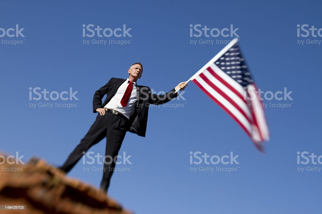 Man holding an American flag royalty-free stock photo