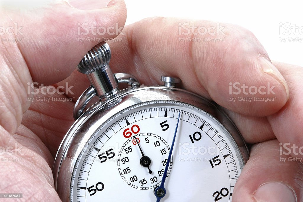 Man holding an analog stopwatch stock photo
