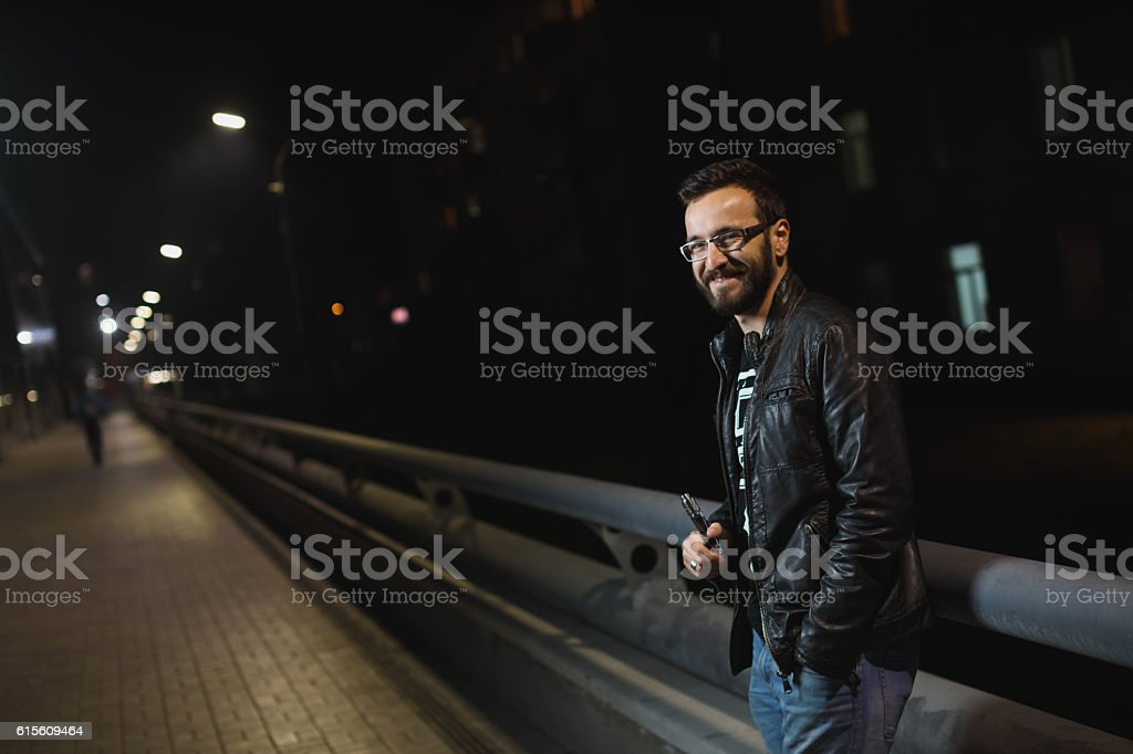 Man holding an electronic cigarette stock photo