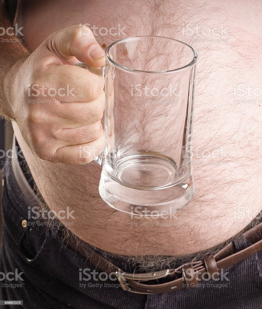 Man holding an empty beer glass royalty-free stock photo