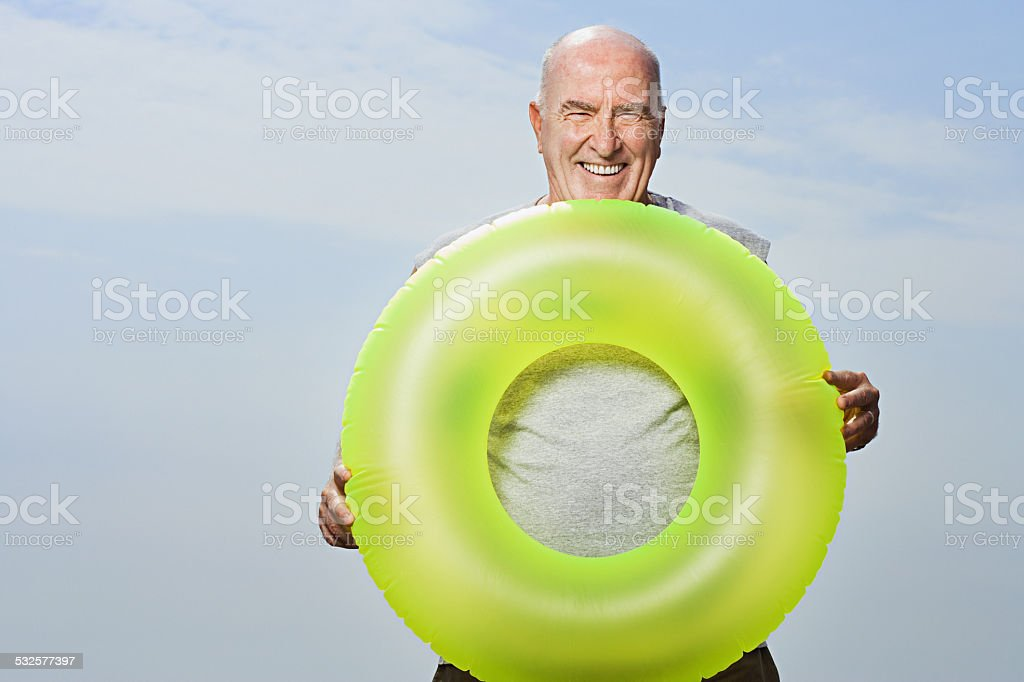 Man holding an inflatable ring stock photo