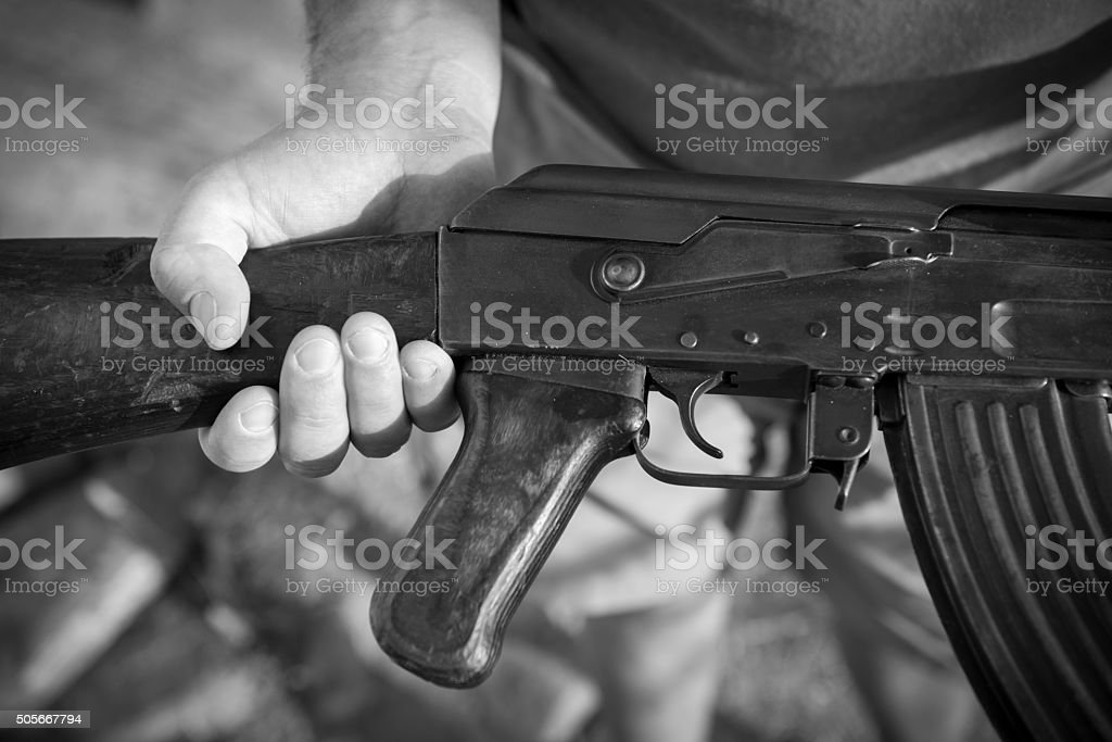Man holding an old Kalashnikov AK-47 from Afghanistan stock photo