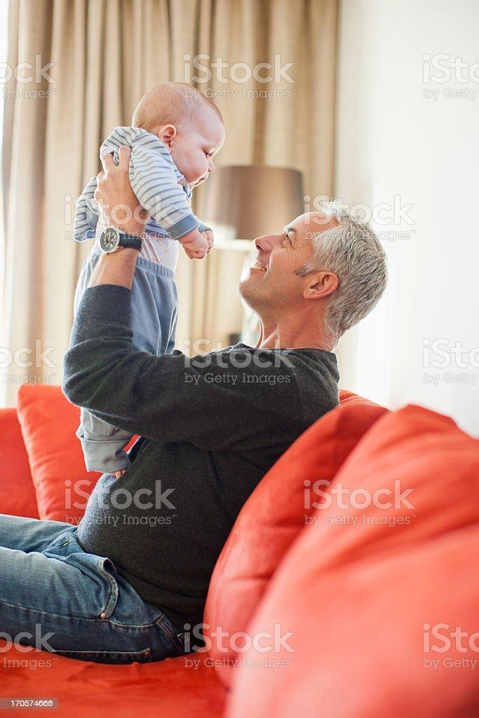 Man holding baby boy on lap royalty-free stock photo