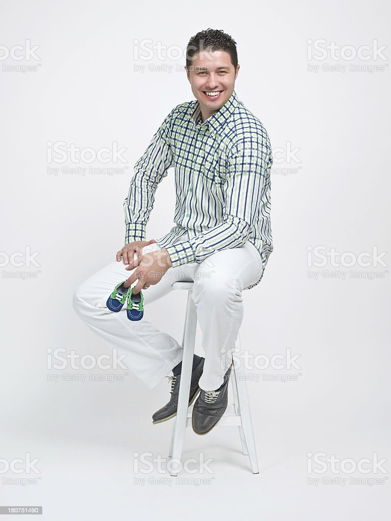 Man holding baby shoes royalty-free stock photo